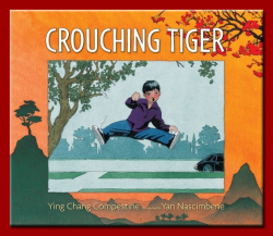 "Crouching Tiger by Ying Chang Compestine, illustrated by Yan Nascimbene (Candlewick, 2011).  Vinson's grandpa has come to visit from China and it turns out that he's a serious marital artist. Vinson wants to learn kung fu, but Grandpa only teaches him tai chi standing meditation.   As the week passed, I felt cheated. Maybe Grandpa didn't know real kung fu. ""Grandpa, my arms are worn out!"" I complained. ""If your arms feel heavy, that shows you need more practice, Ming Da."" Although he spoke English perfectly well with Dad, Grandpa always talked to me in Chinese. ""My name is Vinson, Grandpa."" ""Your Chinese name is Ming Da. You are Chinese as well as American,"" he said firmly.  Chinese New Year's comes and Grandpa takes Ming Da to the parade, giving him a new red silk jacket to wear. Grandpa surprises Ming Da and lets him be the cabbage boy for the Lion dancers, telling him to swing the cabbage just out of reach of the lions. The story closes as the two are walking home after the parade with Ming Da promising to keep practicing his martial arts.  (Image source: Ying Chang Compestine's website)"