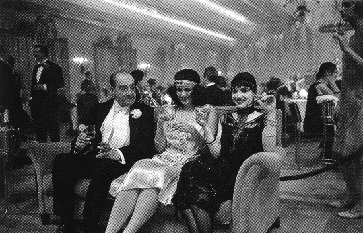 the-overlook-hotel:  Stanley Kubrick's daughter, Vivian (R), smiles as she sits with other extras on the Gold Room set of The Shining.