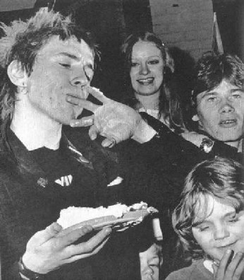 youaintpunk:  The Christmas gig you did in Huddersfield in '77, you got cake pushed in your face by a bunch of kids. Can you tell us about that? Rotten: 'All true. Right, well Huddersfield was at a time when we were banned from playing any normal gigs. So what we did on Christmas day was we rented a venue and invited the kids from the local orphanages down and also the children from the striking firemen and garbage collectors. We did two performances, one for a regular crowd that night, but in the day for all those kids. And we set it up that there'd be like Christmas cakes and all of that and the kids just went wild with it, and why not? It was the best gig I think I've ever done. You know, to be playing to ten or eleven year olds really getting yak and dancing to songs like 'Bodies', and not finding it offensive at all. They saw it for what we were, a hilarious laugh; not frightening, not monsters from hell.'  Amazing home footage of this gig was featured on a BBC Christmas special a few years ago about people's Christmas home movies from the 50s-80s!