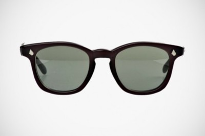 "Self Edge American Optical Modified Sunglasses Self Edge, the boutique self-professed as the ""ultimate denim source"" online, also appreciates some of the finer accompaniments to a vintage pair of jeans. Like these slightly modified American Optical horn-rimmed sunglasses. Starting with dead stock AO frames, Self Edge first dyes, then sandblasts each frame to achieve a smooth, matte finish. Then, the original plastic lenses are replaced with a tinted, modern glass lens for maximum UV protection. The end result is a beautiful, unique, and modern update to one of AO's most classic frames. Each frame ships with a custom Zip Stevensen leather case. Two frame colorways in very limited quantities are available — you can make your choice and pick up a pair at Self Edge."