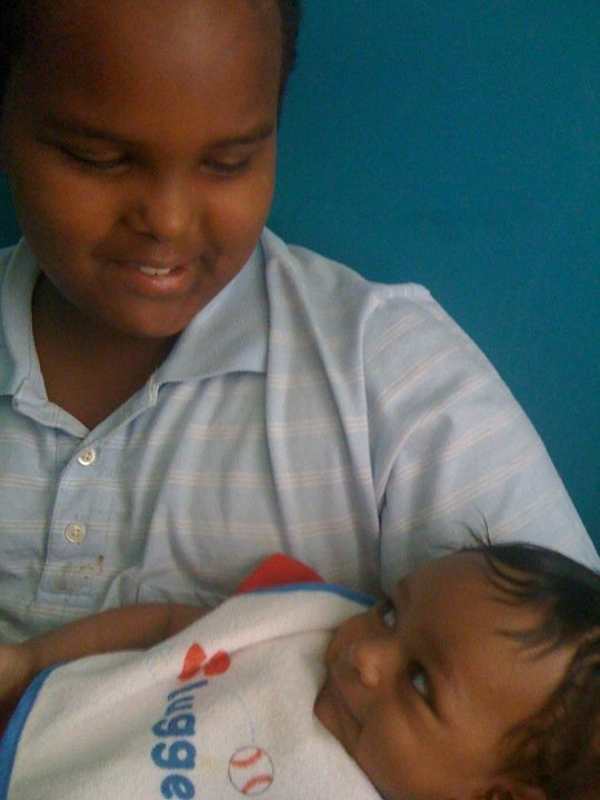 My little brother, Amin holding 4 month old Sammi. I'm so glad I captured this beautiful shot. I can't stop smiling!
