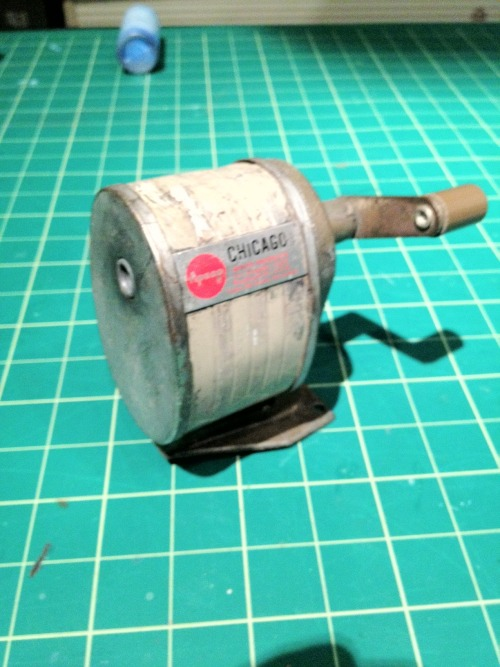Antique, wall mounted, school pencil sharpener. Works great. - $5  Can't you just hear that ol' familiar, grinding sound as you melt pencil after pencil down to an extremely sharp nub in just seconds?  You can, can't you.  It's super affordable, cool looking, a conversation piece, AND it'll also help if you need to make stakes in preparation of a mini-vampire attack!