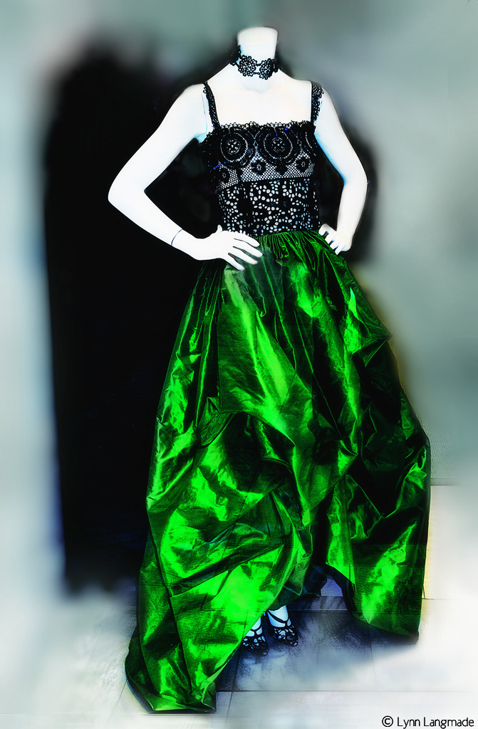 """Eco-Chic"" Submitted for #SaturdayStyle's special St. Patrick's Day Edition, curated by myself and +Lane Langmade Since #SAS is going ""green"" today, I thought I might submit a fashion shot that is both literally green and eco-friendly—thus, celebrating all things green on St. Paddy's Day while also illustrating the way the fashion industry is increasingly becoming committed towards a new mode of environmentalism and social responsibility. The couture gown below is from Oscar De La Renta's Spring 2012 line, and it's made out of emerald silk taffeta and battenburg lace with a broderie anglaise bodice. Notice the asymmetrical hem lines here, which is a recent couture trend. If it looks familiar, you might have seen Nicki Minaj wearing this gown at the 2012 American Music Awards. I took this shot in the Oscar De La Renta boutique in Vegas—cuz when I wasn't doing all kinds of sinfully pleasurable things at night there, I was shopping until I almost dropped. While this gown is beautifully designed, it becomes even more attractive once you realize it was created by an eco-friendly designer. Sustainable fashion is a design movement in which a product is created and produced with consideration to the environmental and social impact it has throughout its total lifespan. This of course includes its ""carbon footprint."" Obviously, one of the major factors to consider is the sustainability of a material. Eco-friendly fabrics include organic cotton, hemp, bamboo, soy, corn and seaweed. Oscar de la Renta, has said, ""Sustainable fashion implies a commitment to the traditional techniques, and not just the art, of making clothes,"" and he has experimented not only with hemp, but also bamboo. So here's to being eco-chic in green —-not just looking ""good"" when partying in some serious style, but feeling good when you do it. You know, all that stuff about being beautiful not just on the outside, but on the inside too. Happy St. Patrick's Day!"
