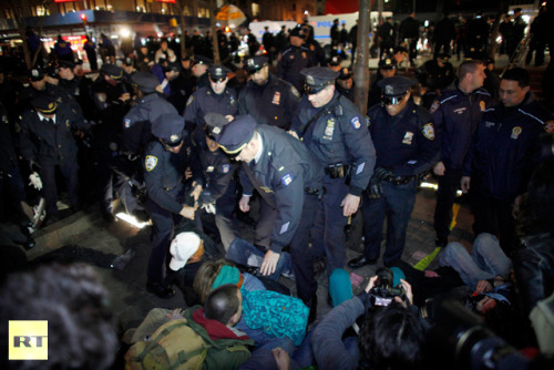 "More reports of police brutality at #M17 in NYC: Cecily McMillan tackled by NYPD, possibly has some broken ribs & had a seizure while handcuffed with officers standing by not offering assistance or an ambulance. She is currently at the hospital & reportedly not allowed to see friends or family or call a lawyer. Shawn Carrie arrested tonight & tweeted - ""Police broke my left thumb and possibly my jaw. My right ear is bleeding and theres a bootprint on my face.""  NYPD bash protester named Jose head against a glass door window, cracking the glass. Video here.  More stories will be updated as they are released."