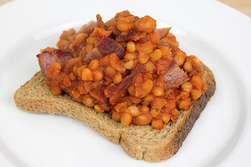 Smokin' Bacon Baked Beans 300g Dried Haricot Beans / 1 Onion / 1 Celery Stick / 1 Carrot / Bay Leaf / Red Onion / 2 Garlic Cloves / Red Wine Vinegar / Smoked Paprika / Brown Sugar / Worcestershire Sauce / Ketchup / 300g Tomato Passata / Salt / Pepper / Oil SOAK Haricot Beans overnight in cold water DRAIN soaked beans and add to a pan QUARTER carrot, celery, onion THROW in pan with beans and the bay leaf and cover with water BRING to the boil then simmer uncovered for about an hour DRAIN beans - saving cooking water - discard vegetables and bay leaf PREHEAT oven to 150C DICE red onion and two cloves of garlic PUT flameproof casserole dish to a medium heat, pour in oil CHUCK in chopped onion and garlic and cook until soft TURN up heat and add two tbsp of red wine vinegar SIMMER until almost evaporated DROP in 2 tsps brown sugar and 1tsp smoked paprika MIX in drained beans ADD 1 tbsp of ketchup and 1 tbsp of worcestershire sauce and stir POUR in 300ml of passata and 200ml of reserved cooking water SEASON well with salt and pepper TURN heat up and bring to the boil TAKE off heat, cover with lid and throw in oven for about 2 hours CRISP up bacon under grill and mix into cooked beans SERVE on toast FOLLOW us on Facebook GO COOK YOURSELF