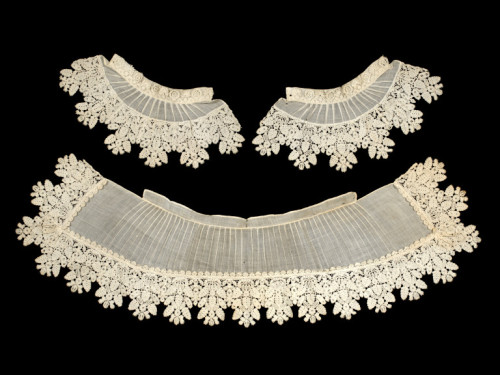 "Devonshire Lace 1635 The Victoria & Albert Museum ""Portraits of women in the 1630s show elaborate ensembles of accessories trimmed with bobbin lace, including two or more collars layered on each other as well as kerchiefs and cuffs. Flemish bobbin lace dominated fashion in the period, its draping qualities complementing the style of dress worn. Light and delicate, made with finer thread and more open patterns than Italian lace, it was ideally suited for such use. The linen parts of the collar and cuffs would have required more frequent washing than the lace edgings. The latter were regularly unpicked and sewn to freshly laundered collar and cuffs. Such a translucent quality of linen, very finely pleated and sewn with tiny stitches and extremely thin sewing thread, is characteristic of 17th century linens. This collar and cuffs may well have formed part of a larger lace ensemble. The lace is made in the bobbin lace technique used for Flemish lace, but its design and the type of thread suggests that it was probably made in England. The quality of English lace in the 17th century was affected by the type of linen thread available. English thread was softer and more irregular than Flemish, though it was praised for its whiteness. Custom for it was at the highest social level. The Countess of Leicester, wife to the English Ambassador to France, was commissioned to purchase English bobbin lace as a present for Anne of Austria, the French Queen, in 1637 and complained of the considerable expense."""