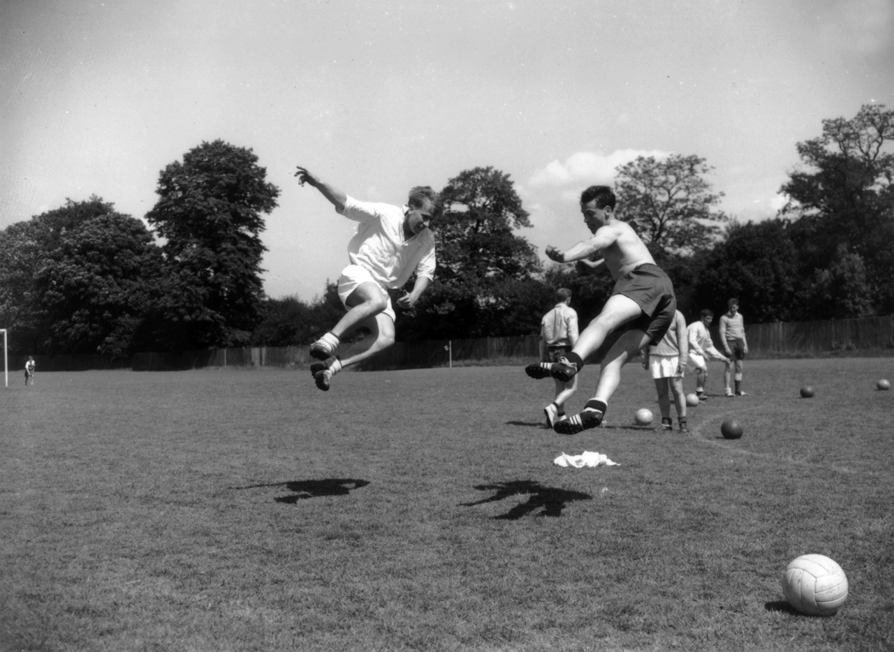 Bobby Charlton and Bobby Robson, frolicking in 1958.
