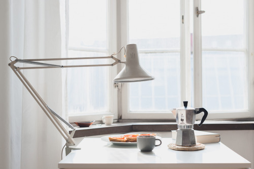 thewholehouse:  white interiors  Perfect desk lamp.