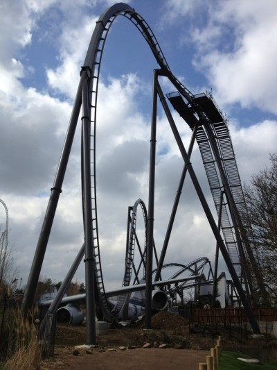 "The Swarm - Thorpe Park @THORPEPARK I have been patiently waiting for this ride to open for just over a year now, and after my first ride I could not be more impressed with a roller coaster! Thorpe Park and Merlin have really pulled out all the stops to make not only a good ride but give an amazing atmosphere and bring in some incredible themed elements too. Let's start with the atmosphere, we all know that THE SWARM has a destruction/state of emergency type feel to it and this was emphasised extremely well with actors placed all around the park (but mainly the new Swarm area). Not only were the actors roaming the area but also the queue screaming, shouting, and giving everyone a great laugh while they waited. We had nurses with cut faces, people with tin foil in their hair and boards around their neck, plus some sneaky arm men who always saluted when you walked past. They even had a fake news crew wondering the park getting the latest news from guests! A touch that I think was appreciated by everyone visiting the park today! The entire Swarm area is very impressive, and does not disappoint. There are so many great viewing points for people who aren't too sure about riding, and there are even some games stands and a little sandwich outlet stand. During my visit they had a selection of live bands playing on a stage just near the entrance of THE SWARM, but I am not sure whether this will continue into next week. When you first approach the area you cannot miss the first drop, which plummets under a destroyed plane wing, which from first sight looks like the best head chopper going, but when riding you are too busy screaming your face off to really notice the height. Around the corner and there are a selection of destroyed/crashed vehicles including a fire engine which conveniently sprays water at riders of THE SWARM, a smoking helicopter and a crashed news 16 reporters van.  My first downside on THE SWARM has to be the queue, it is your standard back and fourth, cattle pen which is calling for queue jumpers to break the park rules! Even though the actors made the small wait enjoyable, I am not sure that this is something which will occur regularly. The station is probably THE best themed station at any UK theme park, even beating out Alton Tower's Thirteen. The blown up church structure has heavy attention to detail and gives a great feel to the ride before setting off up the chain hill. The two big things that guests will notice when walking into the station are the size of the track, it is stupidly huge, and secondly the upside down Police inspection unit which also functions as the control room for the ride! Thorpe Park have implemented a ""card"" front row rider scheme which if I am honest I am not sure will work with queue jumpers but for the number of guests today it didn't really matter!  Now for the ride, right? What everyone has been waiting for! Well 9 out of 10 Thorpe Park, what an incredible roller coaster. I experienced all three positions, front, middle and back, but the back has to be the best by a long shot! The first drop is a spectacle, from the front you slowly turn down towards the large decent, and from the back you rapidly spin through the air! Either way, both are different experiences which all keep guests happy!  The first drop is by far the best, but don't forget the small heart-line roll towards the end which spins riders through the roof of the church in a crazy whirlwind! There are also some water elements throughout the ride which, if your lucky, get some riders wet. I have to admit that I don't really get scared or nervous about rides anymore but a good coaster for me is one that is enjoyable, this ride kept me laughing the entire way around! On a final note, the seats could not be more comfortable if they tried, with a similar layout to AIR at Alton Towers, it gives guests the ability to sit comfortably but still feel free when riding through the air. I wanted to share with everyone how amazing this new roller coaster is, and I am positive it will attract a large influx of guests for the park!  THE SWARM, Thorpe Park 9/10"