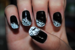 "nailxobsession:  black with white crackle tips.Products used:black: Wet n Wild fast Dry ""Ebony Hates Chris""white crackle: Sally Hansen Crackle Overcoatsilver striper: Stripe Rite"