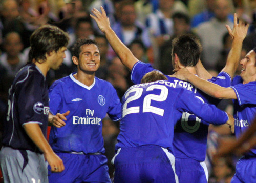 Chelsea's John Terry celebrates with Frank Lampard , Eidur Gudjohnsen and Paulo Ferreira after scoring while Porto's Diego walks past during their Champions League Group H soccer match at Stamford Bridge in London September 29, 2004. Chelsea won the match 3-1.