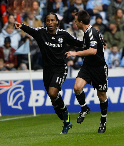 Chelsea's Didier Drogba celebrates his goal against Coventry City with John Terry during their English FA Cup sixth round  match at the Ricoh Arena in Coventry, central England, March 7, 2009.
