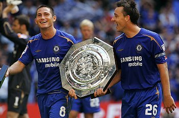 John Terry  and Frank Lampard celebrate with the trophy after winning the Community Shield  match against Arsenal at the Millennium Stadium in Cardiff, Wales, August 7, 2005. Chelsea won the match 2-1.
