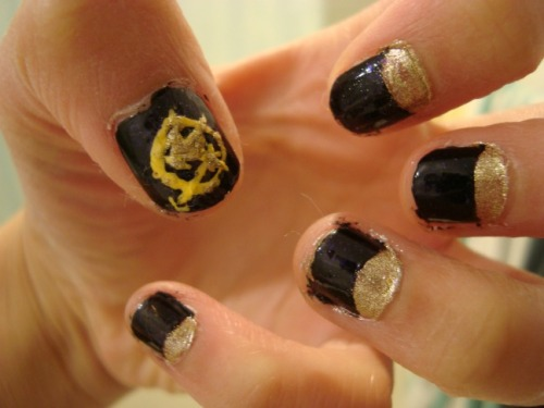 Hunger Games nails + Half moon manicure. SUPER excited for the midnight premier (:
