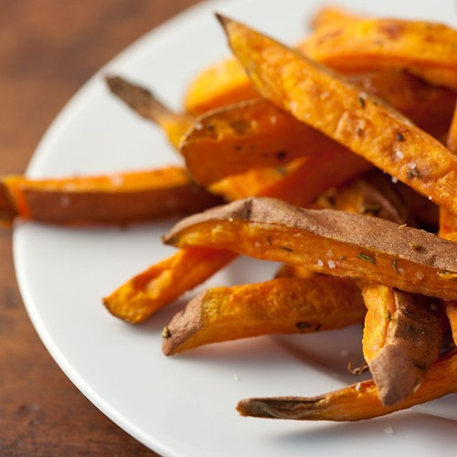 "muffintop-less:  HEALTHY Sweet Potato ""Fries"" Ingredients: 1 tsp chopped fresh rosemary leaves 1 tbsp olive oil 1 lb sweet potatoes (about 3 medium) 1/4 tsp sea salt Instructions: Preheat oven to 425°F. In a small bowl, combine rosemary and olive oil; set aside. Scrub potatoes and remove any blemishes. Cut each potato lengthwise into 1/2-inch slices. Stacking 2 slices together, cut each into 1/2-inch strips. In a large bowl, toss potato strips with rosemary mixture until evenly coated. Spread potatoes on a large parchment-lined baking sheet in a single layer. Bake for 30 to 35 minutes, flipping potatoes over halfway through baking time, until lightly browned. Remove from oven, sprinkle with salt and serve warm. http://www.cleaneatingmag.com/Recipes/Recipe/Quick-Sweet-Potato-Fries.aspx"