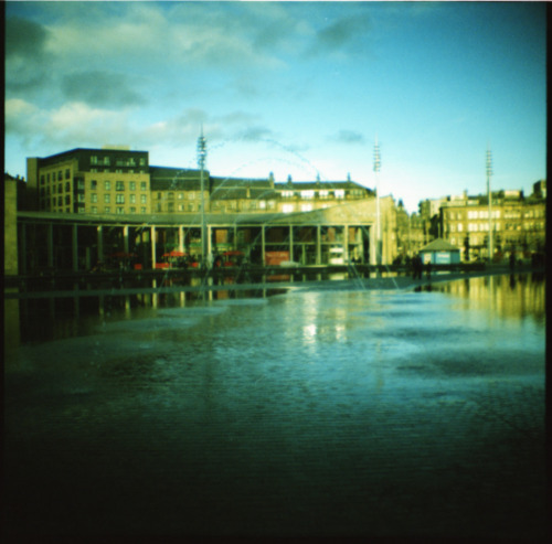 Bradford Mirror Pool. Taken on Diana Mini with cross processed expired Kodak E100VS.