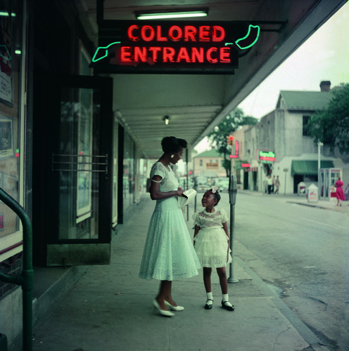 thereisnogod:  hollyhocksandtulips:  Photo by Gordon Parks   Human stupidity, because you get diseases by entering the same doorway as a colored person. Duh.