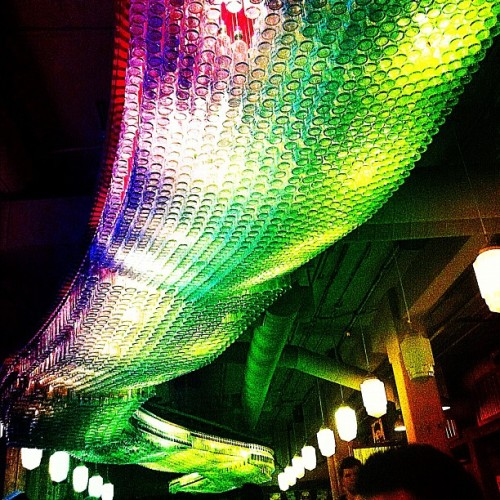 Bottles Light Installation - #light #fixture #art #modern #popular #iphoneography #art  (Taken with Instagram at Loose Moose Tap & Grill)