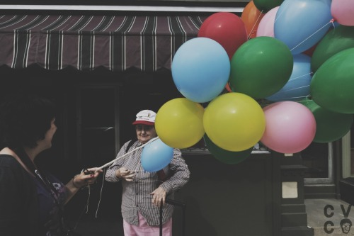 a shot from documenting Amber handing out balloons to people in downtown Warren, PA