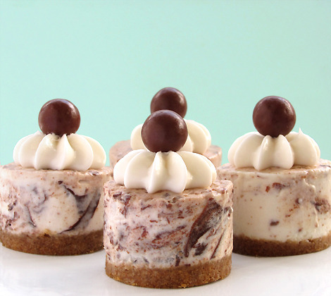 Chocolate Butterscotch No-Bake Cheesecake Yield: 16 2-inch cheesecakes or 1 9-inch cheesecake Ingredients For crust: 1 1/2 cup crushed graham cracker 1/4 cup packed light brown sugar 7 tbs unsalted butter, melted For cheesecake:  1/4 cup water 1 tbs powdered gelatin 2 1/4 cup heavy cream 1 lb cream cheese, softened 2/3 cup sugar 1/2 tsp coarse salt 1/3 cup Whoppers, pulverized 1/4 cup chocolate chips 1/4 cup butterscotch chips 2 tbs fresh lemon juice Instructions   For crust: Combine graham cracker crumbs with sugar. Add melted butter and blend. Press into pan. Set aside. For cheesecake: Bring 1 inch of water to simmer in bottom of double boiler. Sprinkle water over gelatin and let stand for 5 minutes. Scrape softened gelatin and place into top of double boiler. Set over simmering water until mixture becomes liquid. Remove from heat and set aside. Crush Whoppers. Set aside. Heat chocolate in microwave for 10-20 seconds, until melted. Set aside. Place butterscotch chips and 1 tbs heavy cream in microwave for 10-20 seconds, until melted. Whisk to combine. Set aside. Beat heavy cream until medium peaks form. Set aside. Add cream cheese, sugar, salt, and lemon juice to bowl. Beat until smooth. Add 1/2 cup of cream cheese mixture to gelatin and fold. Return gelatin mixture to remaining cream cheese mixture and fold. Fold in crushed Whoppers. Gently add butterscotch and chocolate sauce by drizzling into mixture and folding only until mixture shows streaks of sauce. (Do not over-mix) Fill pan with slight mound at center. Refrigerate for at least 6 hours or overnight. Serve with whipped cream and garnish with Whopper.   —