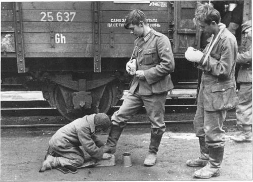 failfail9:  Russian boy earns some extra money by shining wounded german soldiers' boots.