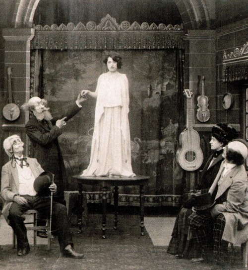Georges Méliès (left, standing) as a medium in the lost film Phantom Apparitions (1910, dir. Georges Méliès) (via)