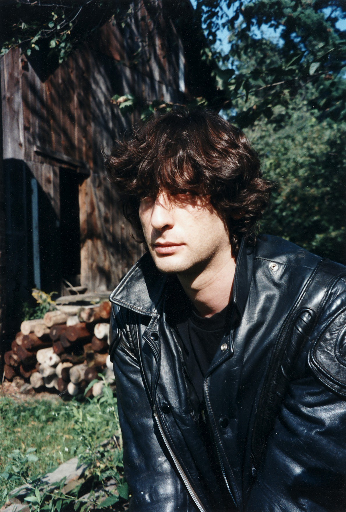 neil-gaiman:  Jill Thompson found some very old photos of me, which she presented me with this morning. This one is from 1995, or perhaps a little earlier. I scanned them to send to Amanda in Australia to cheer her up after her mini bike-accident today.  I thought I'd post this one, as the most amusing of the lot. I am so brooding. Look I am so brooding. This is me being brooding. In case you were wondering I am brooding or something.