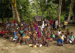 Blonde kids in Langania village, New Ireland Island - Papua New Guinea by Eric Lafforgue on Flickr.When you ask the people why there are so many blonde people on the islands, they answer 3 things: they have white ancestors, they receive too much sun, or they do not eat enough vitamins! © Eric Lafforgue www.ericlafforgue.com