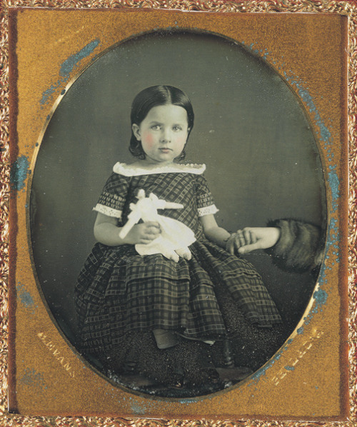ca. 1850's, [daguerreotype portrait of a young girl holding a doll and an anonymous hand], Charles Evans via the George Eastman House Collection, Still Photograph Archive