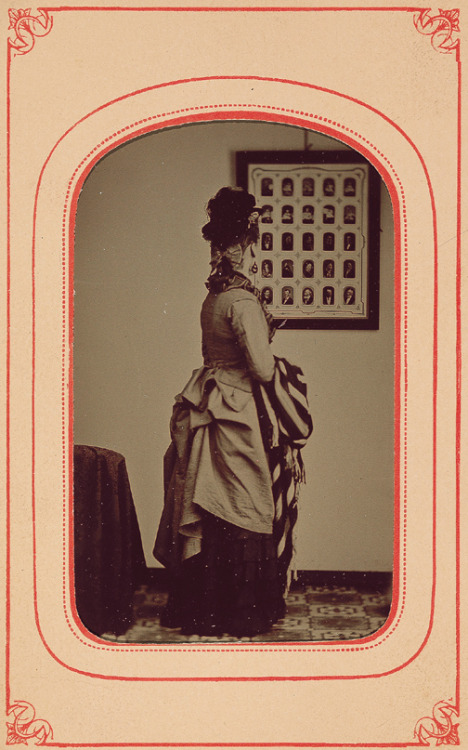 ca. 1870, [tintype portrait of a woman admiring framed tintypes] via the George Eastman House Collection, Still Photograph Archive