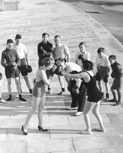 Two female members of a keep fit group learn boxing techniques as part of self defense lessons. (Photo by Reg Speller/Fox Photos/Getty Images). 7th December 1935