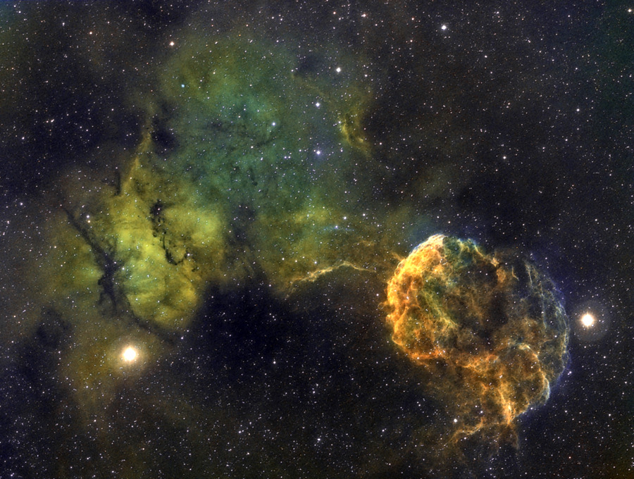 unknownskywalker:  S249 Region by César Cantú The image shows the Jellyfish Nebula or IC443 to the right, and IC444 to the the left. The first is a planetary nebula which shelters a neutron star, the product of a star that exploded about 30,000 years ago and left a very large remnant; it is located about 5,000 light years away. In the picture the nebulae are flanked by the stars Mu and Etas in the constellation Gemini.