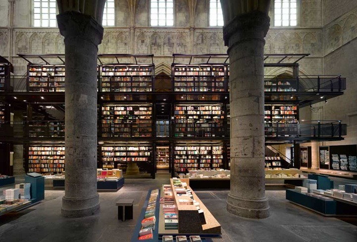 architizer:  A bookstore inside a 13th century Gothic cathedral in Holland.