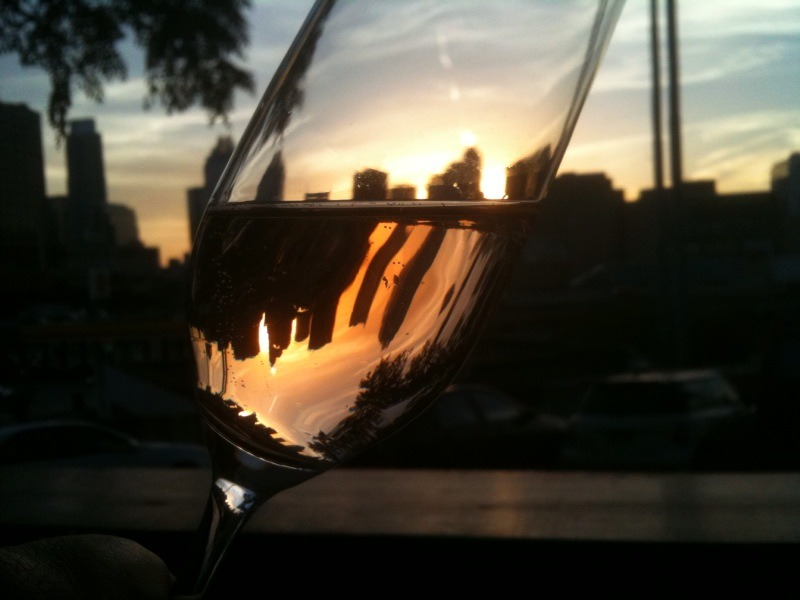 Sunset with a glass of bubbly and the Austin skyline in the backdrop from the patio at Uncorked. Photo by yours truly taken with my iPhone.