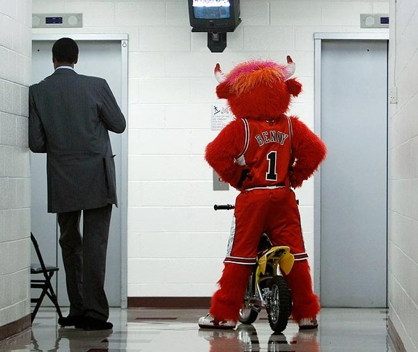 Former Chicago Bulls forward Scottie Pippen & Benny the Bull wait for the elevator at the United Center.