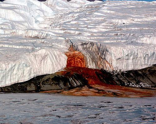 This mysterious blood-red waterfall is located in Antarctica. The red color is partially the result of saltwater tainted with iron oxide, but the real mystery of these falls is what lives in the water. Water samples contain almost no oxygen, but at least 17 different types of alien-like microbes have been identified slithering around in the water. Scientists surmise that they survive via a metabolic process never observed in nature that utilizes sulfate as a respiratory catalyst with ferric ions, metabolizing trace levels of ancient organic matter trapped underneath Antarctica's vast glaciers.14 amazing waterfalls