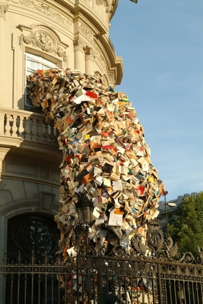 flavorpill:  Sculptures of books exploding out of buildings