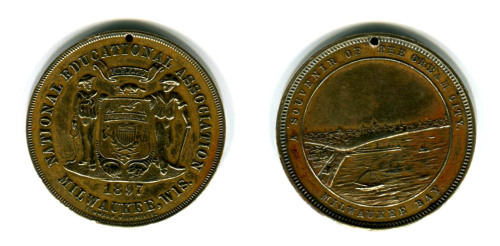 This silver dollar sized token came from the 1897 meeting of the National Education Association in Milwaukee. (I know that they currently hold annual meetings, but back then I can't be certain how often they met.) The NEA formed in 1857 and today it is the largest professional employee organization with well over 3 million members. They represent every level of faculty & staff that work in the education field ranging from Pre-K through graduate school, and apparently one of my ancestors was once a member. This NEA medal has a hole in the top that I believe was added. There was a trend back then of taking tokens like this and then converting them into necklaces. So I believe this is what happened here. Besides that hole, it is in pretty good shape. The details of Milwaukee Bay are still nice and crisp and the Wisconsin State Seal on the flip side is also pretty decent (thought it appears the State Seal has changed a bit since then). I know this came from my Mom's side of the family, but as to which ancestor owned this I can't be certain. I do know that this side of my family had a line that lived in Fond du Lac, so maybe that is the side this came from. I guess I've got something to look into.