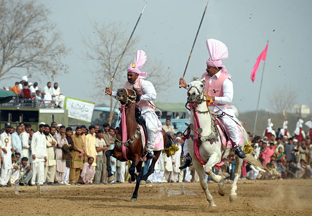 Horse riders participate in a tent pegging competition in Islamabad over the weekend. The competition in Pakistan's capital city Islamabad is taking place for the first time since 2004.  (FAROOQ NAEEM/AFP/Getty Images)