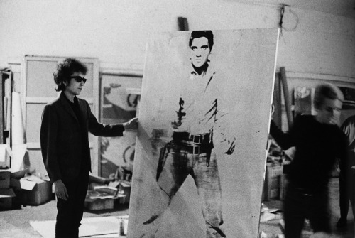 ummhello:  Bob Dylan holding Double Elvis [Ferus Type] at the Factory at 231 East 47th street, New York, 1965