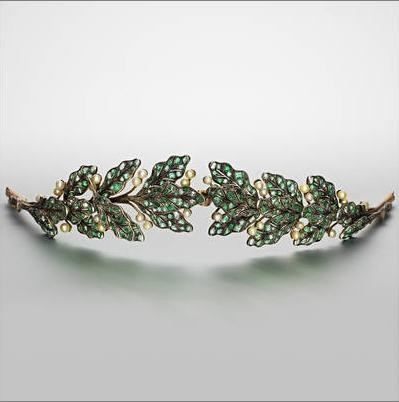 ornamentedbeing:  An emerald, pearl and diamond tiara, circa 1900 Designed as a laurel wreath, pierced and millegrain-set with circular, step and mixed-cut emeralds, interspersed with pearl 'berries' and rose-cut diamond stems