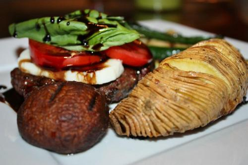 """Caprese"" Burger with a Balsamic glaze, alongside grilled zucchini, mushroom and a ""Sliced"" baked sweet potato."