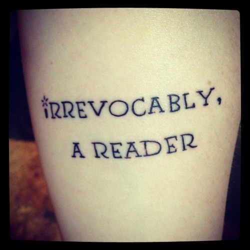 "tattoolit:   ""At one magical instant in your early childhood, the page of a book—that string of confused, alien ciphers—shivered into meaning. Words spoke to you, gave up their secrets; at that moment, whole universes opened. You became, irrevocably, a reader.""  -Alberto Manguel  This quote was in the very beginning of the first text book I had for my first core class as a library science major, and it has stuck with me ever since. And it seemed fitting to get it in a font based off of the font used for the chapter titles in the Harry Potter series, as Sorcerer's Stone is the first book I remember sitting down and devouring in one weekend."