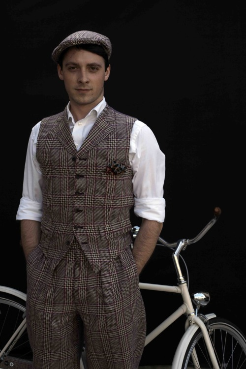 Photographed by Horst Friedrichs in Paternoster Square before the Tweed Run. Photo featured in Cycle Style by Mr Friedrichs. Wearing Dashing Tweeds cap, waistcoat and breeches. Bike by Abici.