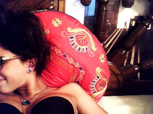also, I picked up a giant, overstuffed, moroccan-style pillow today from pier 1 and have decided to repaint/redecorate my entire room to match it.