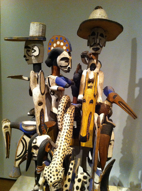 nigerianculture:  Complex sculpture by Cecca W on Flickr. Via Flickr: Wood, iron and paint Igbo people, Nigeria, 20th century The sculpture is made of many separate elements nailed to a central core and incorporates images of power, such as horsemen, imported goods, military insignia, rifles and wild beasts. Such works act as the fixed rallying points of different social groups at public displays of dancing.