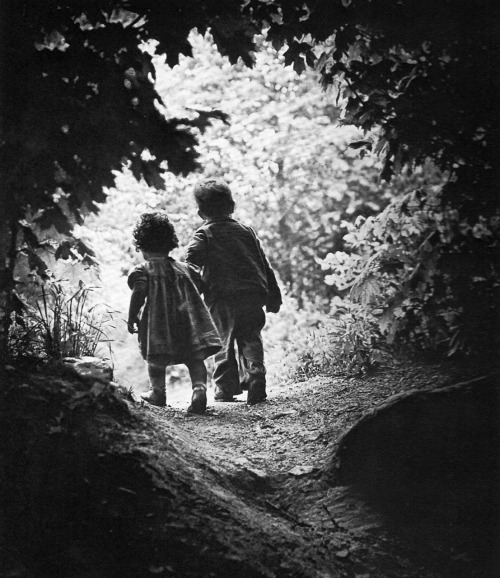 W. Eugene Smith | The Walk to Paradise Garden, 1946 This is the first photograph that Smith took after two years of recuperation for injuries sustained while covering World War II. As he writes (collected in Art and Artist):  The children in the photograph are my children, and the day I made this photographic effort, I was not sure I would be capable of ever photographing again.…It was a good day on which to try. A beautiful, warm spring day to cradle a man's efforts to reclaim himself. The children…approached a clearing roughly arched by the trees, and I became acutely sensitive to the lines forming the scene and to the bright shower of light pouring into the opening and spilling down the path toward us. Pat saw something in the clearing, he grasped Juanita by the hand and they hurried forward. I dropped a little farther behind the engrossed children, then stopped. Painfully I struggled—almost into panic—with the mechanical iniquities of the camera…I composed the setting as I labored…tried to, and did ignore the sudden violence of pain that real effort shot again and again through my hand, up my arm, and into my spine…swallowing, sucking, gagging, trying to pull the ugly tasting serum inside, into my mouth and throat, and away from dripping down on the camera where it would obscure the clarity of the image…preparing, testing, checking the approaching merger of the subject factors…tensing tighter and tighter the delicate pressure on the shutter release, trying to anticipate in time to defeat my reaction lag…and, as the children stepped in space, to complete my foreseen composition, I pressed the camera release to retain the image of that instant—to hold secure on film the vision of this minute fraction of time floating within eternity. The reaction was immediate. I knew the photograph, though not perfect, and however unimportant to the world, had been held. Shock waves of feeling released through me, breaking damply out of my flesh…I was aware that mentally, spiritually, even physically, I had taken a first good stride away from those past two wasted and stifled years.