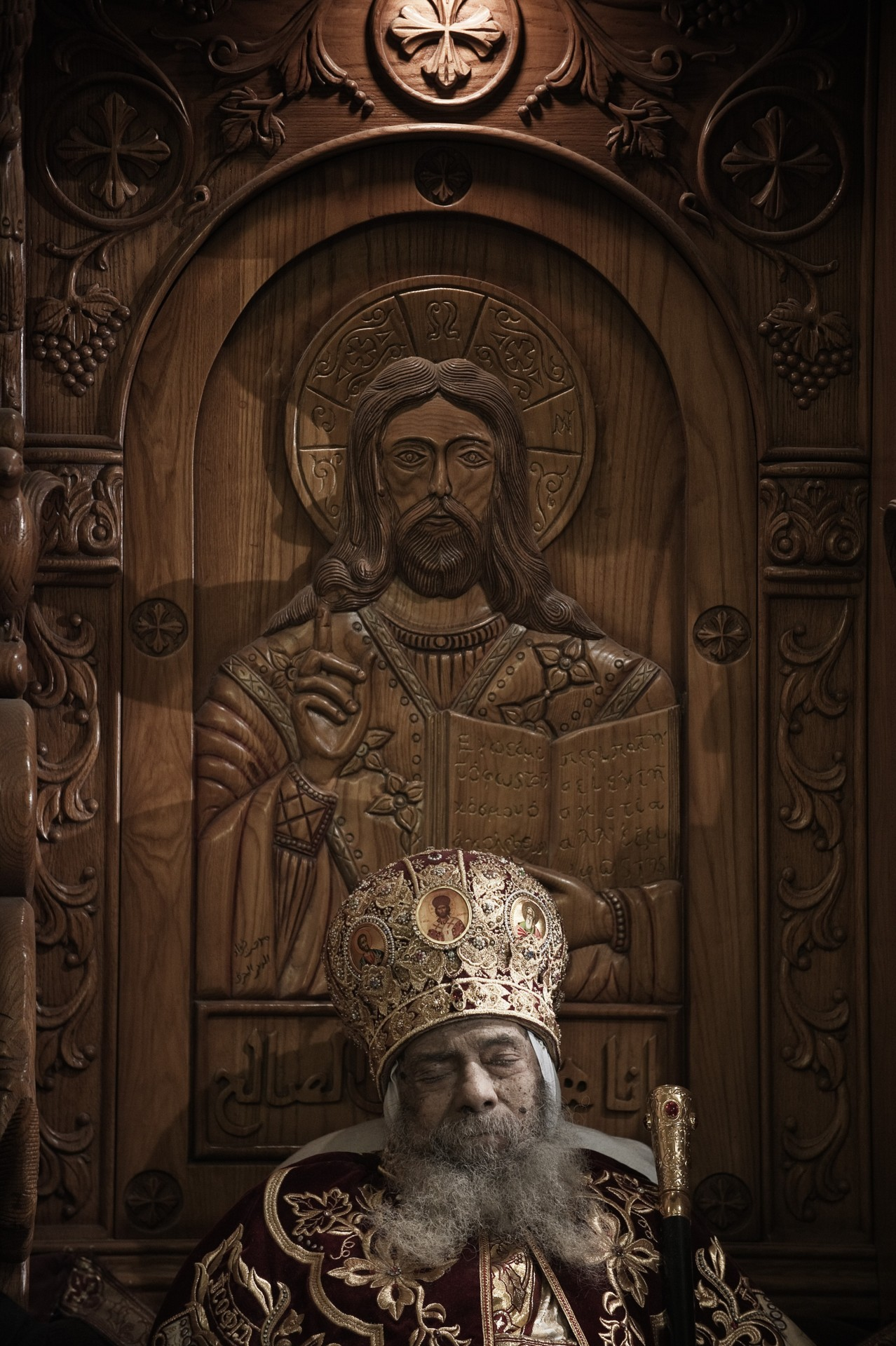 Pope Shenouda III at Rest at St. Mark's by Trent Gilliss, senior editor The body of Pope Shenouda III, the spiritual leader of the Coptic Orthodox Church, sits dressed in formal robes on a wooden throne at Saint Mark's Coptic Cathedral in Cairo's al-Abbassiya district. Mourners are paying their respects to the man who reigned over the Middle East's largest Christian minority group. He was 88. After a long illness, he died on Saturday and will be buried today at St. Bishoy Monastery in Wadi Natrun in the Nile Delta where he spent his time in exile after a dispute with late president Anwar Sadat. Photo by Gianluigi Guercia/AFP/Getty Images)