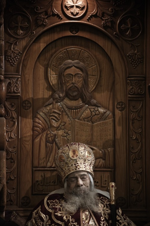 Wow, what a photo… beingblog:  Pope Shenouda III at Rest at St. Mark's by Trent Gilliss, senior editor The body of Pope Shenouda III, the spiritual leader of the Coptic Orthodox Church, sits dressed in formal robes on a wooden throne at Saint Mark's Coptic Cathedral in Cairo's al-Abbassiya district. Mourners are paying their respects to the man who reigned over the Middle East's largest Christian minority group. He was 88. After a long illness, he died on Saturday and will be buried today at St. Bishoy Monastery in Wadi Natrun in the Nile Delta where he spent his time in exile after a dispute with late president Anwar Sadat. Photo by Gianluigi Guercia/AFP/Getty Images)