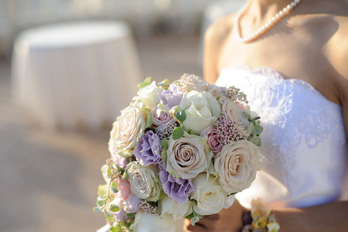 Pastel coloured hand tied bridal bouquet
